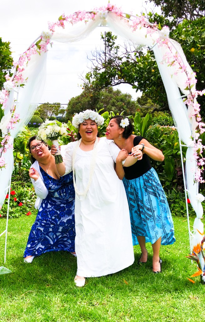 A photo of my sisters and I at my wedding having fun. We have fun when we're together and I love them.